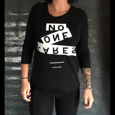 """""""No One Cares"""" ALL CLOTHING is either NWT, RETAIL or PRE-LOVED that has been worn a few times &  cleaned properly.  too expensive , gonna break da bank ? Then add me to a  b u n d l e  or use the offer button    n o  l o w  b a l l i n g  REASONABLE offers accepted . I QUICKLY DECLINE OFFER requests that are 40% below asking price .      N O T R A D E S   Tops Tees - Long Sleeve"""