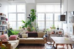 Creative Director, designer and stylist Victoria Bartlett has filled her Bed-Stuy loft with a collection of vintage furniture, antiques, and plants.