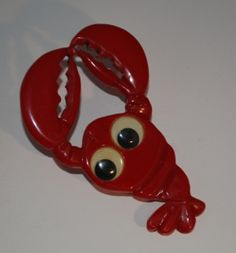 A wonderfully cute vintage Bakelite lobster brooch.  - this would be cute to wear to the beach ;)
