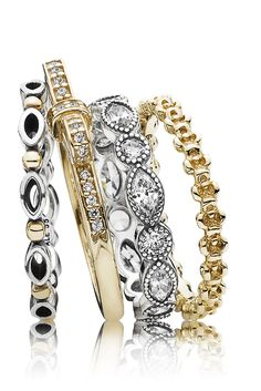 Create a glamorous look by stacking silver and gold rings with dazzling stones. #PANDORA #PANDORAring