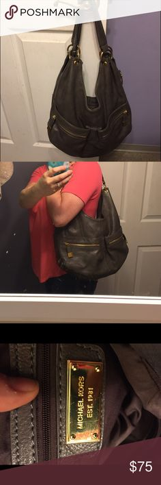 Michael Kors purse Good used condition. This is a large bag with lots of pockets. Has two slip pockets on both front and back of the outside of the bag. Two zipper pockets on the outside on the front of the bag. Inside has two zip pockets and two slip pockets. Gray is a brownish gray color and has gold hardware. Only sign of wear is the handles have started to crack slightly as shown in pic #4. Leather outside, cloth interior. This bag can hold so many things and keeps things organized with…
