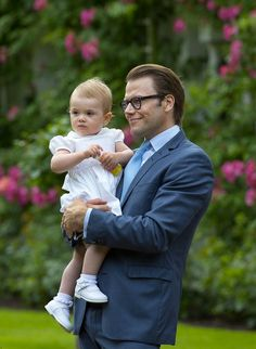 Princess Estelle of Sweden daughter of Crown Princess Victoria, with her father Prince Daniel.