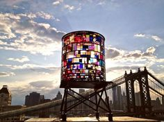 Tom Fruin's sculpture, Watertower in DUMBO, Brooklyn.Consists of about 1,000 scraps of plexiglass from all over New York City, ranging from old sign shops to closed-down artist studios and various warehouses.