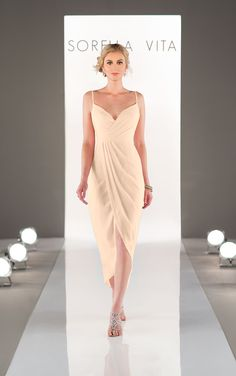 Perfect for a beachside wedding, this chiffon bridesmaid dress features a crossed-sweetheart bodice and delicate spaghetti straps. The wrapped skirt has an asymmetrical hem that hits at the trendy midi length.
