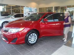 Evelyn with her beautiful, cherry red 2013 Camry LE! Welcome to the David Maus Toyota family! #Toyota #WhateverItTakes