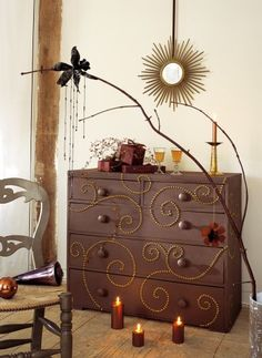 Dresser decorated with furniture tacks, random spirals. Love it!