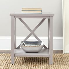 The perfect place to put books or a reading lamp, this simple rectangle end table from Safavieh will add storage to any room in your home. It is made of poplar wood for durability, and the soft gray color will coordinate with many home decor schemes.