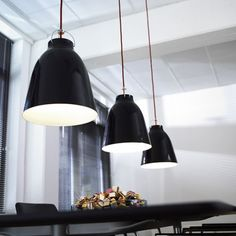 The painter Caravaggio worked wonders with light. Danish designer Cecilie Manz created the Caravaggio pendant lamp to provide a simple and elegant design that is suitable for many applications — it comes in five sizes ranging from a small pendant Industrial Lighting, Modern Lighting, Pendant Lighting, Chandelier, Pendant Lamps, Industrial Design, Industrial Interiors, Ceiling Pendant, Industrial Style