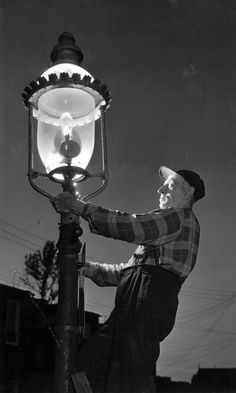 In 1957, the last gas street light was extinguished in Baltimore and replaced by mercury vapor lamps. Putting out the lights, shown above, had started in the early 1950s. Baltimore was the first city to use gas lamps, in 1817. The old gas lamps were sent to Cape May, N.J. and Disneyland. (Aubrey Bodine, Baltimore Sun photo, 1957)