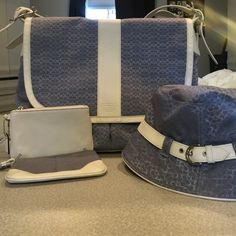 100% Authentic Coach laptop bag! Wristlets & Hat! Lightly used Coach cross body carrier bag, perfect for your lap top with matching (P/S) Bucket Hat and 2 wristlets. Every item was barely used and in good condition. Only selling this item because I am moving and cannot fit all of my stuff :( Every item is authentic! The bag measures 15x12x5 Coach Bags Laptop Bags