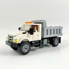 A Medium-Duty Dump Truck with a Ford cab. I have skyscraper constructions round the clock and the least I can do is MOC up a dump truck that my minifig crew can work with! in scale with all of my vehicle MOCs, can seat 2 figs up front. Scrap Mechanics, Lego Village, Ford F650, Lego Universe, Lego Machines, Lego Truck, Lego Speed Champions, Lego Construction, Vintage Lego
