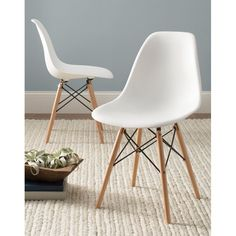 Add a splash of retro style to any space in your home with this sleek and sophisticated side chair. Inspired by midcentury designs and modern aesthetics, this accent chair will liven up your look with chic style. The soft curving seat showcases wood grain-style detailing in a neutral finish that elegantly contrasts the clean-lined design of the simple flared wood legs. The seat also features an ergonomic shape for inviting appeal. Try pulling a few of these chairs around a sleek white table…
