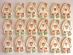 These cottage style houses with a heart on the front are supposed to be for christmas but how cute to give out these as edible valentine's day cards.. Very green! Make the cookies out of sugar cookie dough instead of gingerbread.