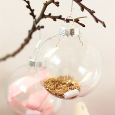 Use glass ornaments, glitter and a sweet message to make this adorable advent calendar