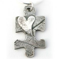 Puzzle Necklace: because all I have are some pieces. God's the only One who can see my entire life, His masterpiece.