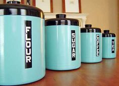 DIY Vintage Canisters. Spray paint old metal canisters and use letter stickers to label them. You can also use letters from magazines and newspapers for a more vintage look.