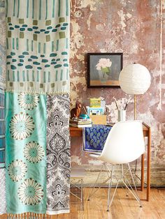 Take scarves, or scrap pieces of material to make either your own curtains, or a little privacy wall for some area.