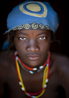Miss Ines is from Mundimba tribe. They live in the south of Angola, in a very simple way. Photo by Eric Lafforgue, via Flickr
