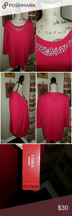 Rhinestone Bodice Sweater Gorgeous Candy Apple red light weight sweater with 3/4 length sleeves material is 72% rayon with 28 % Rayon.  Has beautiful clear rhinestones on the neckline and Bodice. Great with jeans or black slacks. Can be worn all year even during the holiday season. Sweaters