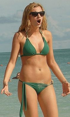 Blonde actress Blake Lively in a green bikini covered with beach sand