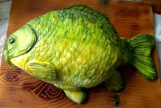 I made this cake in 2012, my brief was to make a cake that looks like a carp. The board was handmade using sugarpaste and the whole cake was airbrushed.