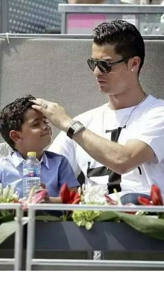 Cristiano Ronaldo and his cute son coordinate hats at Madrid Open Cristiano Ronaldo Junior, Cristiano Ronaldo Juventus, Cristiano Ronaldo Cr7, Real Madrid, Cr7 Jr, Cr7 Junior, Cristino Ronaldo, Good Soccer Players, Best Football Team