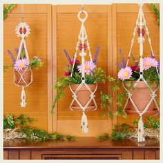 This macrame hanging planter is adorned with beaded flowers, picot loops and knotted twists! Wood beads in cheerful colors of rose pink and apple green add a touch of sweetness while the cream color cord keeps it looking classic. This hanging planter is available in multiple sizes