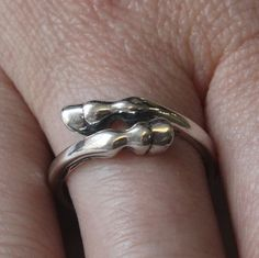 It looks like a tiny horse is hugging your finger! Horse Hoof Ring in Sterling Silver. $49.00, via Etsy.