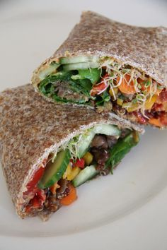 I'm laying in bed right now, letting round two of these incredible sprouted veggie wraps digest in my stomach. Once I feel the stomach is ready for some intermediate action, then I'll c… Healthy Eating Recipes, Raw Food Recipes, Veggie Recipes, Lunch Recipes, Healthy Food, Vegan Wraps, Healthy Wraps, Tortilla Wraps, Quick Healthy Breakfast