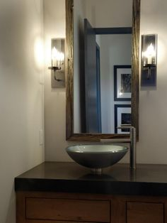 A tempered, frosted-glass vessel with a single-handle faucet stands in for a traditional undermount sink.