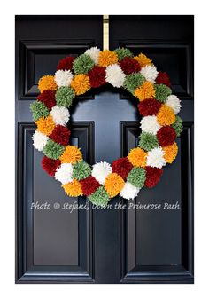 Cute Pom Pom Wreath! Can see this in Christmas colors, Easter colors, Halloween colors...everything!