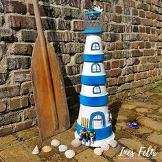 Lighthouse for the garden I always wanted to have a lighthouse made of clay pots in the garden, but it should also light up. Clay Pot Crafts, Diy Home Crafts, Pvc Pipe Projects, Diy Craft Projects, Seaside Pictures, Clay Pot Lighthouse, Garden Whimsy, Diy Store, Light Crafts