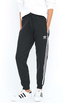Shop adidas Originals Knitted 3 Stripe Black Joggers at Urban Outfitters today. Black Joggers, Black Knit, Knitted Fabric, Awesome Stuff, Adidas Originals, Latest Fashion, Urban Outfitters, Sweatpants, Autumn
