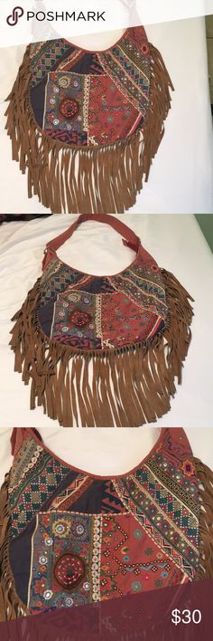 I no longer use it but it's too cute to let sit It's very boho/hippy Urban Outfitters Bags Baby Bags