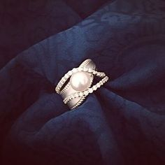 This beautiful diamond and Mikimoto pearl ring was designed and created for a customer right here in our shop! We can't brag enough on our amazing designers & artisans!