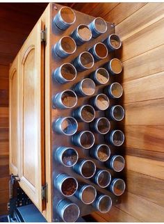 Take a sheet of metal and put it up on the end of a cabinet and attach magnetic spice jars to it! Great way to save space in an RV.