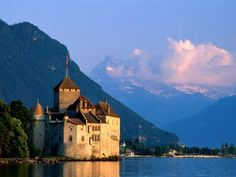 """World's Coolest Castles"" (12) Chateau de Chillon - Switzerland  For more than 1,000 years, Chateau de Chillon has rested on the shores of Lake Geneva, in the shadows of the Swiss Alps."