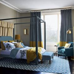 Combine teal with pops of ochre for a warming and harmonious bedroom scheme. This four-poster bed with an upholstered headboard and curtain makes an inviting focal point