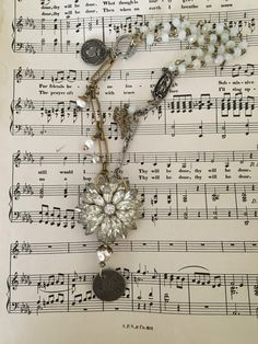 Gorgeous necklace featuring a repurposed 1950s rhinestone brooch!