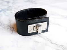 Handcrafted leather cuff bracelet with silver twist lock. Find this and other stylish leather accessories in Anthology shop on Etsy - pinned by pin4etsy.com