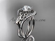 """platinum diamond celtic trinity knot wedding ring, engagement ring with a """"Forever Brilliant"""" Moissanite center stone CT7244"""