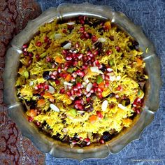 Persian Jeweled Rice Persian Jeweled Rice is a spectacular rice pilaf topped with colorful gem-like fruits and nuts ~ this popular Middle Eastern wedding dish is a celebration in itself. It's gluten free, vegan, and incredibly delicious! Rice Recipes, Vegetarian Recipes, Cooking Recipes, Healthy Recipes, Easy Recipes, Risotto, Spiced Rice, Iranian Food, Thanksgiving Side Dishes