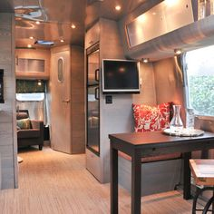 Airstream. I like bamboo look flooring. Curious how they keep table from falling when in motion.