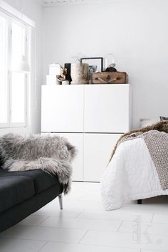 Stacked IKEA Besta units in a bedroom