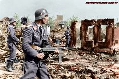 Luftwaffe troops securing areas recently overran by Soviet troops at Stalingrad, suburb of Minina, September 19, 1942. The man in the foreground, Oberleutnant der Reserve Helmut Wilhelm Schnatz, Chef of 3.Batterie/Flak-Regiment 25, would die later that same day. Possibly the last photograph of him. -