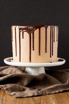 A rich dark chocolate cake with a silky mocha swiss meringue buttercream. | livforcake.com
