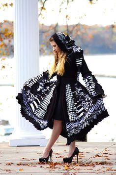 Custom Recycled Black and White Sweater Coat with a Medieval Liripipe Hood and Bell Sleeves by SnugglePants- Jour et Nuit. $488.00, via Etsy.