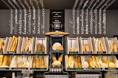 Bread Boxes and Titles up the wall. Bakery Store, Bakery Display, Bakery Cafe, Bakery Shop Design, Coffee Shop Design, Cafeteria Vintage, Bakery Interior, How To Store Bread, Bread Shop