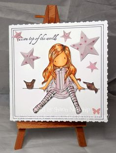 "Blank card cut and border drawn with Cricut Explore. Gorjuss girl is ""on top of the world"". 3D stars cut on the Cameo. Papers by First Edition ""Love Owl"""
