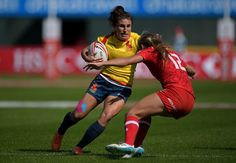 Maria Casado of Spain is tacked by Megan Lukan of Canada during Day One of the Emirates Dubai Rugby Sevens - HSBC Sevens World Series match between Canada and Spain at The Sevens Stadium on November 30, 2017 in Dubai, United Arab Emirates.